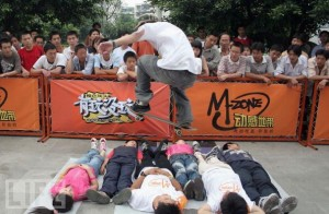 Chinese skateboarder jumping